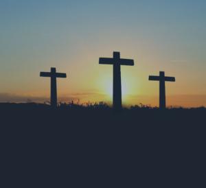 Religious crosses against a sunscape